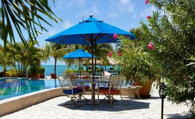 Chabil Mar Belize Resort Nth Pool with Table and Umbrellas